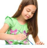 Little girl is painting with gouache Royalty Free Stock Photo