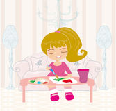 Little  girl painting her dream house on large paper canva Royalty Free Stock Photos