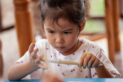 Little girl is painting her hand Royalty Free Stock Images