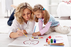 Little girl painting with her mother Royalty Free Stock Photography
