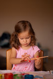 The little girl painting Royalty Free Stock Images