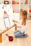 Little girl painting a house Royalty Free Stock Photo