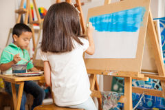 Little girl painting a landscape Royalty Free Stock Photos