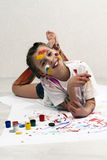 Little girl painting, laying on the floor Stock Photography