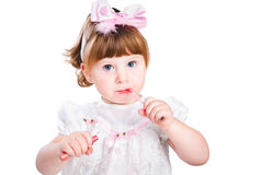 Little girl painting makeup lipstick isolated Stock Image