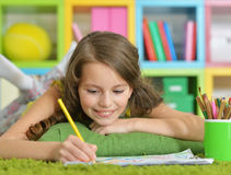 Little girl painting with pencil in her room Royalty Free Stock Photo
