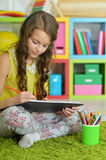 Little girl painting with pencil in her room Royalty Free Stock Photos