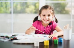 Little Girl Painting Picture. Little Girl Is Painting Picture royalty free stock photos