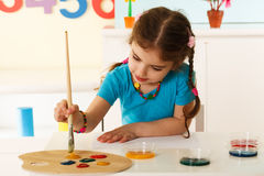 Little Girl Painting royalty free stock photography