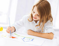 Little girl painting picture stock photo