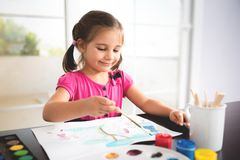 Little Girl Painting Picture At Home Royalty Free Stock Photos