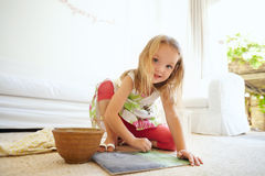 Little girl painting a picture at home Stock Image