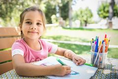 Little Girl Is Painting Picture Outdoors Stock Images