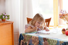 Little girl painting picture with watercolor Stock Photos