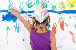 Little girl when painting Royalty Free Stock Images