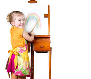 Little girl painting a rainbow Stock Image