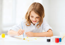 Little girl painting at school Stock Photography