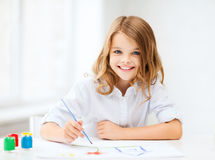 Little girl painting at school Stock Photo