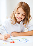 Little girl painting at school Royalty Free Stock Image