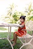 A little girl painting water colors on a table at home garden Royalty Free Stock Photo