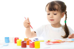 Little girl painting with watercolor Royalty Free Stock Photography