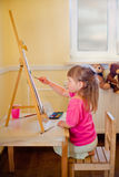 Little girl painting Stock Image