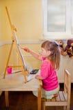 Little girl painting Stock Image
