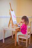 Little girl painting Royalty Free Stock Images
