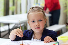 Little girl painting watercolors Royalty Free Stock Photography