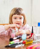 Little girl paints her nails Royalty Free Stock Photography