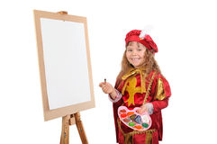 Little girl with paints near an easel Royalty Free Stock Image