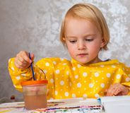 Girl paints with watercolors royalty free stock images