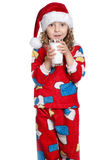 Little girl in pajamas Stock Images