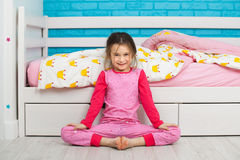 Little girl in pajamas doing morning exercises at home Royalty Free Stock Photography
