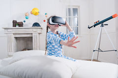 Little girl in pajamas playing in virtual reality headset Stock Photography