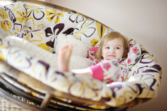 Little girl in pajamas on sunny morning Stock Image