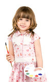 Little girl with palette. The small nice girl holds a palette and a brush in hands,  smiles.  Profile Adobe RGB (1998 Stock Photos