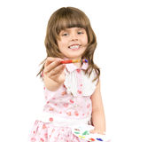 Little girl with palette. The small nice girl holds a palette and a brush in hands, draws, smiles.  Profile Adobe RGB (1998 Stock Images