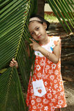 Little girl with palm frond Royalty Free Stock Photography