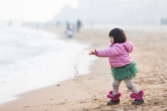 Little girl. Palying on the beach stock photo