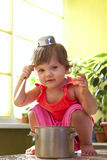 Little girl with a pan and ladle Stock Photography