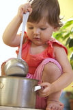 Little girl with a pan and ladle Royalty Free Stock Images