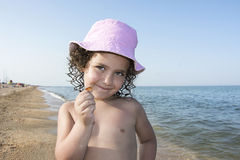 Little girl in panama sea shell summer holds. Stock Images
