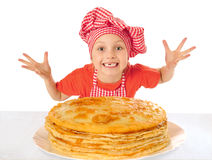 Little girl with pancakes Stock Image