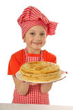 little girl with pancakes smilling Royalty Free Stock Images