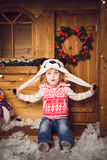 Little girl in panda hat with christmas decoration Stock Photography