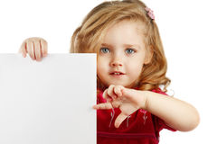 Little girl with a paper. Little girl with a white paper in hand Royalty Free Stock Images