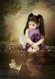 Little girl and paper boat Royalty Free Stock Photography