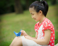 Little girl with paper crane Royalty Free Stock Images