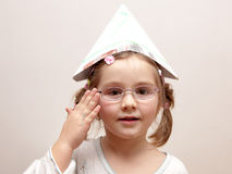 Little girl with a paper hat Royalty Free Stock Photos